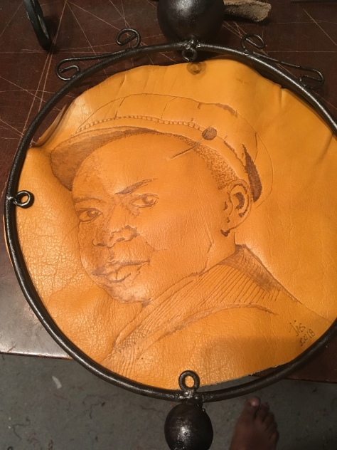 Leather Burning image in suggested round, iron frame with fabric backing