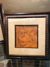 Leather burned art framed for the Love Field Exhibition