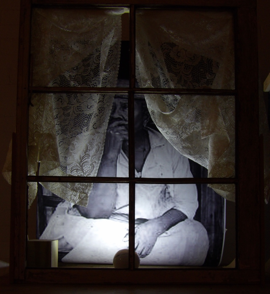 Photography with wood window and curtains--night lit view--Copyright JasMardis